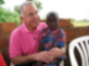 Reese_with_child_in_Zambia-300x225.jpg