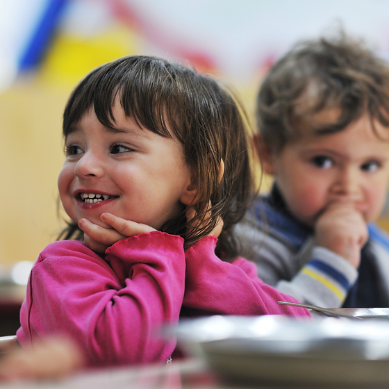 Two young children smiling