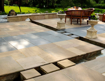 Sandstone and slate stepping stones cross the rill