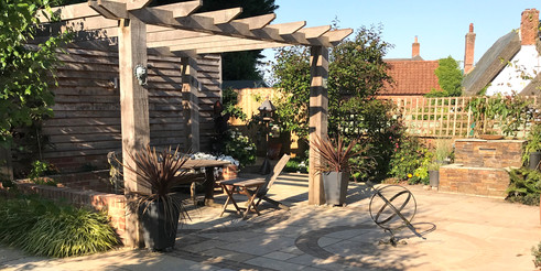The pergola keeps the focus within the garden