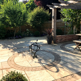 Armillary sphere as a focal point in a circle of sandstone setts