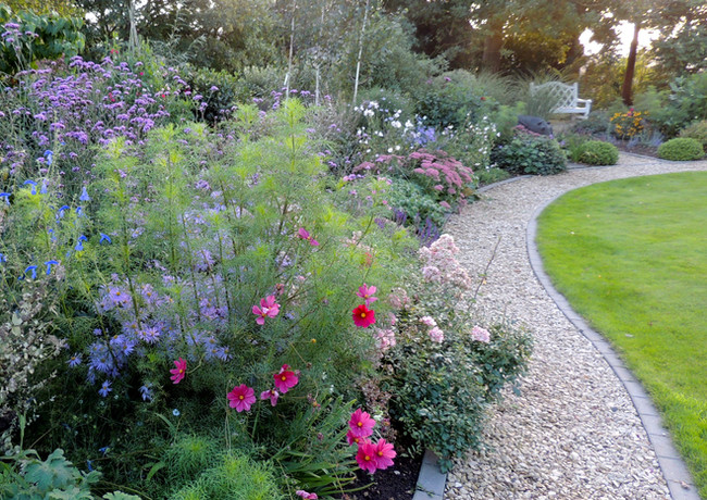 Gently curving path alongside a mixed border