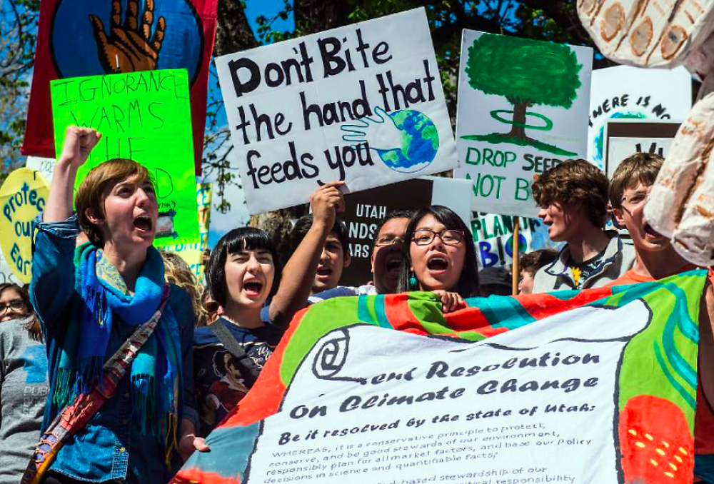 From left to right: Piper Christian, Genesis Wardle, Kiyan Banuri, Josh Velazquez, Keely Toledo, and Kai Torrens at the Utah People's Climate March