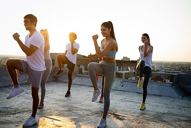 group-of-happy-fit-friends-exercising-ou