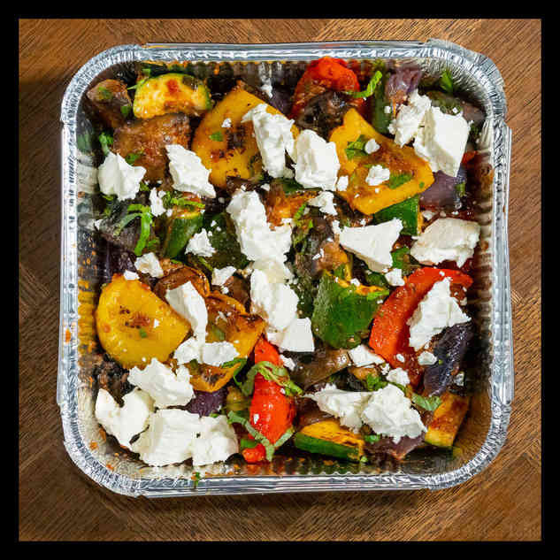 Ratatouille with crumbled feta and pine nuts