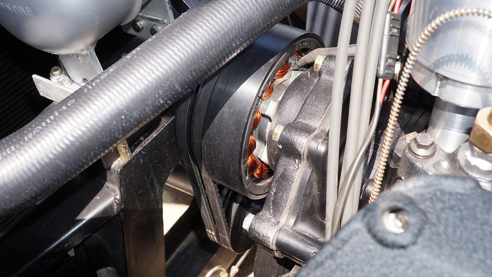 Water pump-mounted alternator