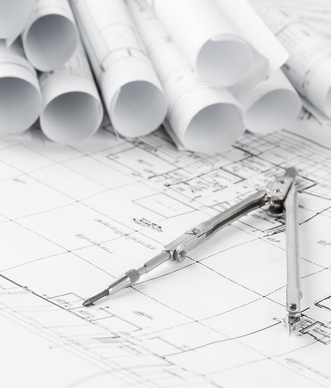 rolls-of-architecture-blueprints-and-hou