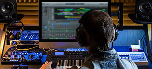 Man-produce-electronic-music-in-studio-1