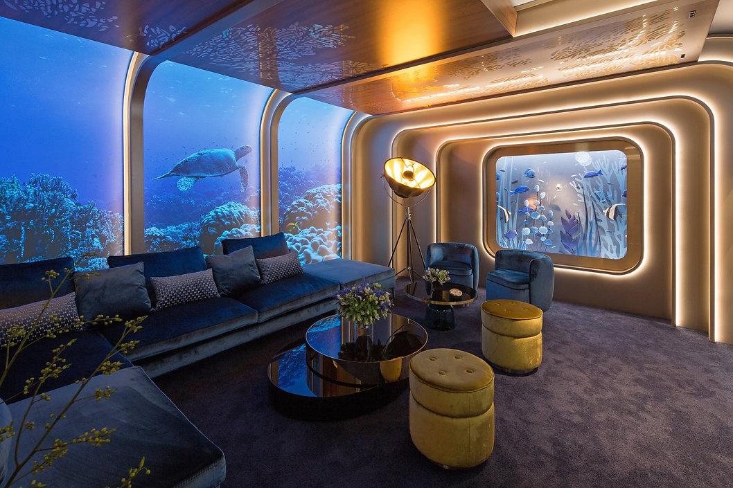 beside-a-fortuny-floor-lamp-an-aquarium-