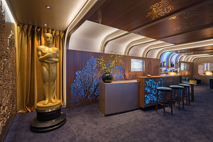 an-oscar-greets-guests-at-the-entrance-t