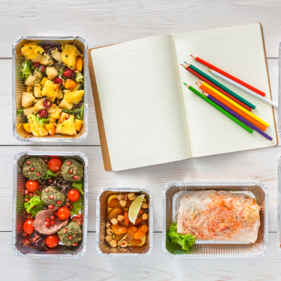 notepad and portioned meals for meal planning