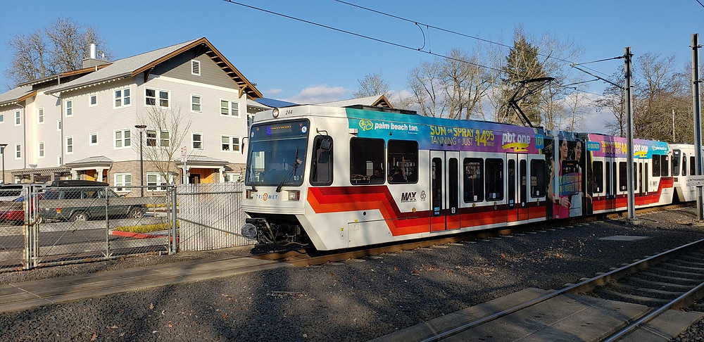 MAX Light rail service runs every few minutes righ across from the lot for sale in Orenco, Oregon.