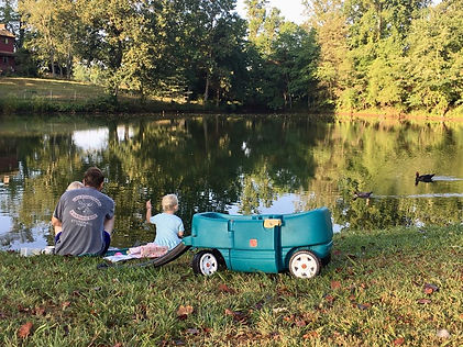 kids sitting at the pond.JPG