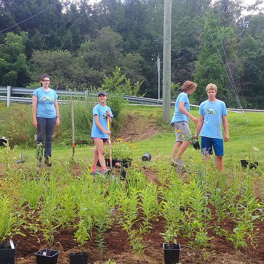 PRWC's Youth Conservation Corp team planting 350 plants in the rain garden.