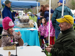 Trout Unlimited led fly tying demonstrations - George Rein left checks out a fly tied by a happy stu