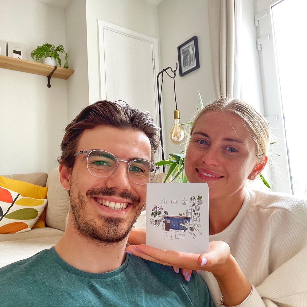 Lewis & Imogen proudly showing off the Mad Lilies gift card illustration