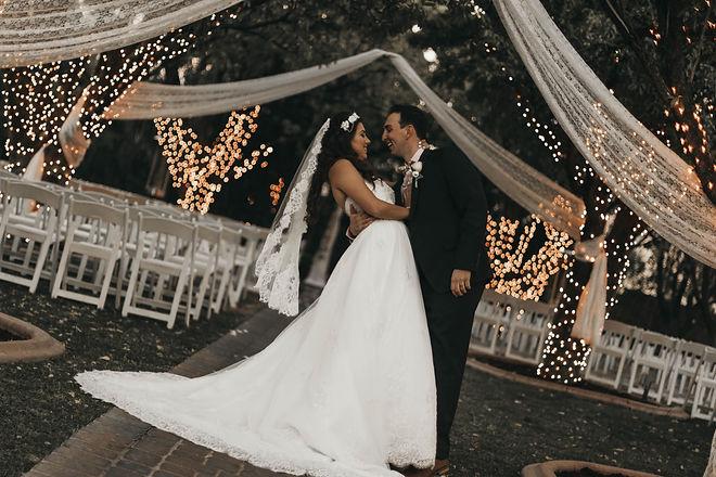 groom and bride standing on narrow pathway_edited.jpg
