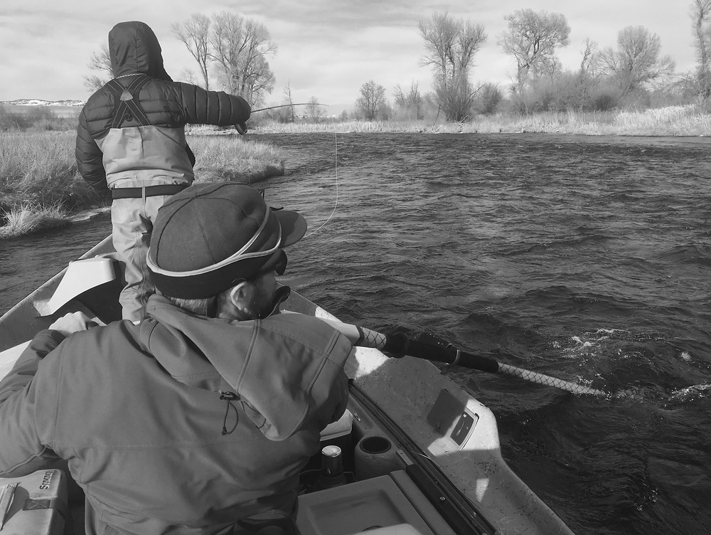 Photo of rowing a drift boat in winter on the Madison River above 8 mile ford.