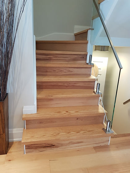 Stair with riser match hickory floor.jpg