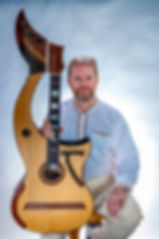 Jon Pickard concert guitarist with 23 string harp guitar