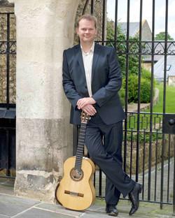 Jon with guitar at wedding venue