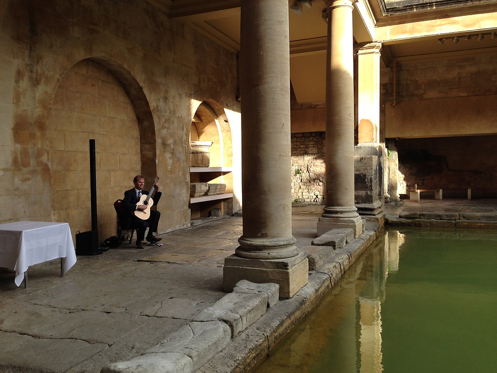 Classical Guitarist with amplifier plays at Roman Baths Wedding