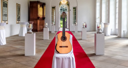 Classical Guitar on red carpet