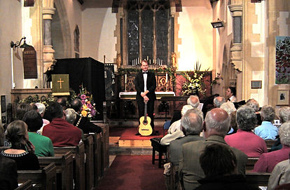 Classical Guitarist talking at concert