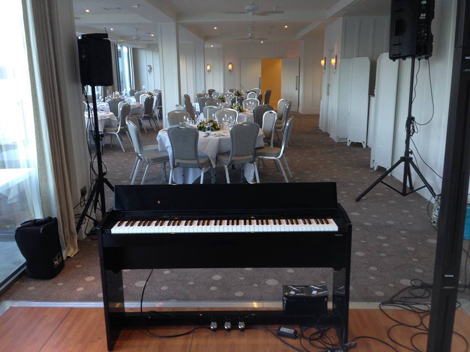 Piano and amplifiers in wedding reception room