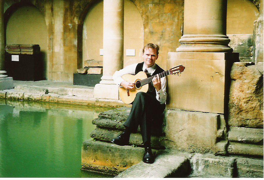 Jon with Guitar in Roman Baths