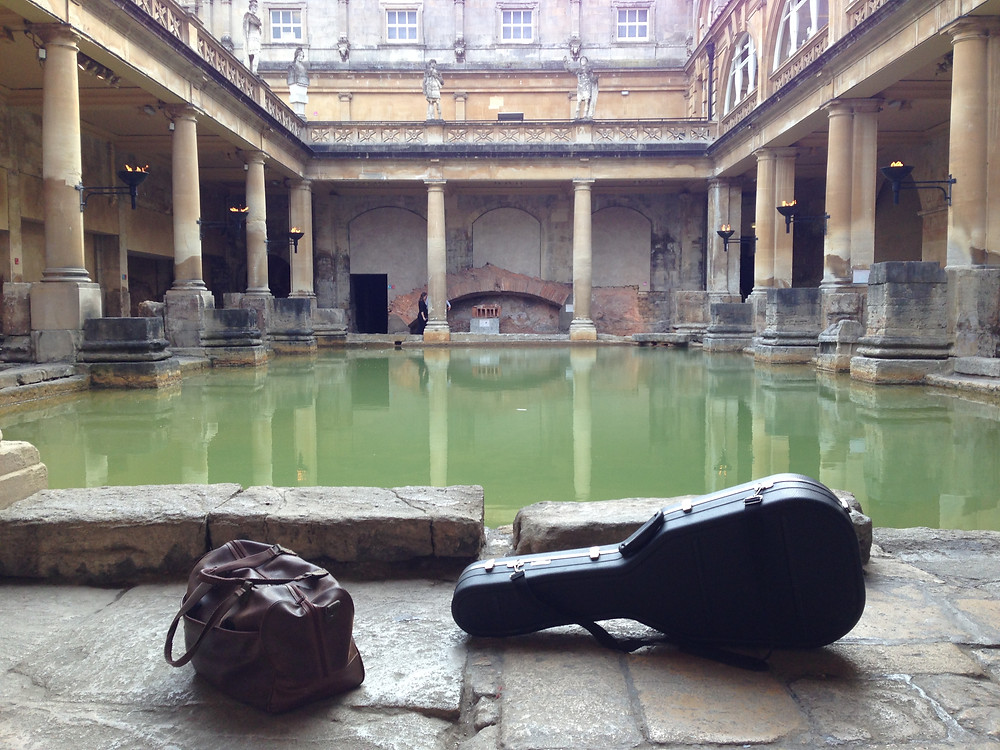 Guitarist arriving in Roman baths before wedding