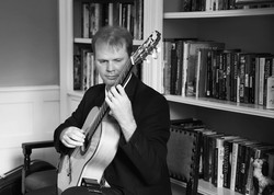 Classical Guitarist in Library room
