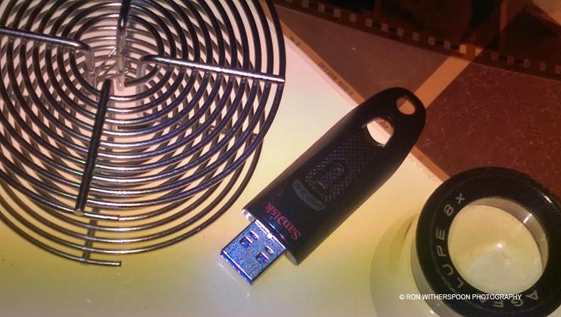 Film spool, loop, negatives, jump drive