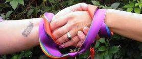 Hand Binding Rainbow ribbons.jpg