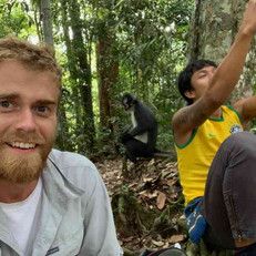 Guest-guide-with-thomas-leaf-monkey-behi