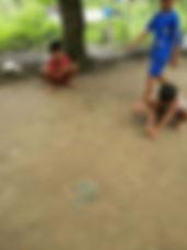 children playing village tour.jpg