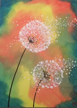 blowing dandelions