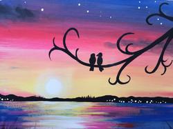 lovebirds in sunset