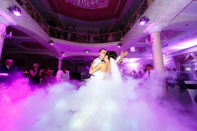 groom-bends-bride-dancing-smoke.jpg