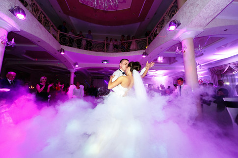 groom-bends-bride-dancing-smoke.jpg