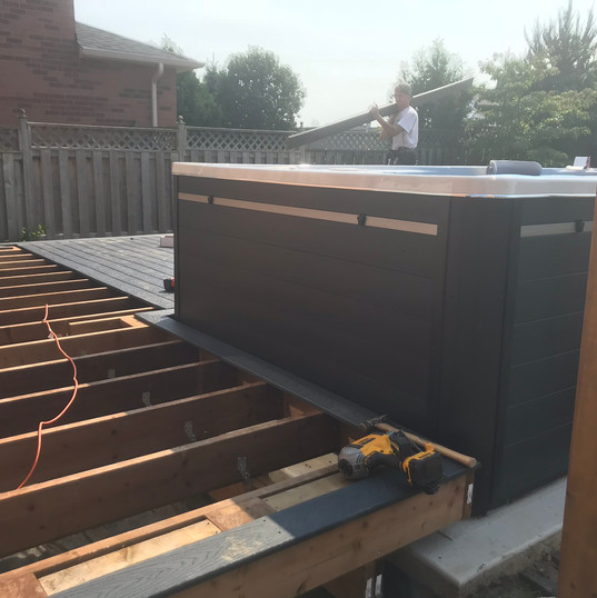 Work on Deck surrounding hot tub