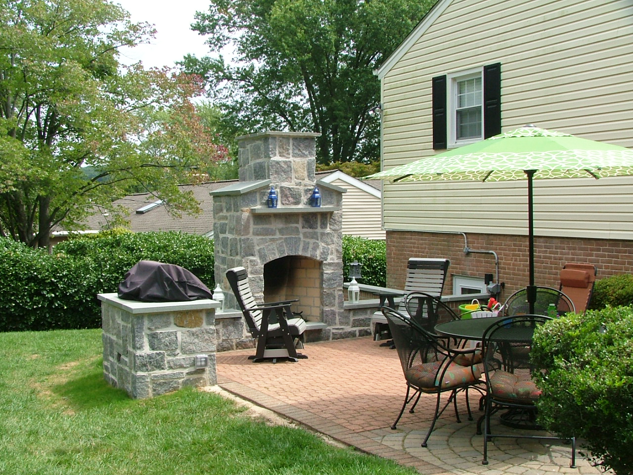 Backyard patio with outdoor fireplac