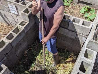 Brad working the compost bin
