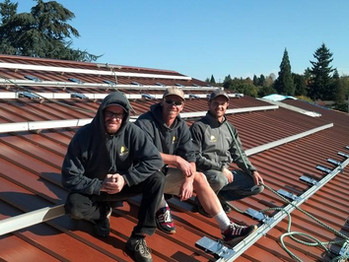 SunBridge Solar Crew Finishing the Rack and Microinverters for the Solar Panels