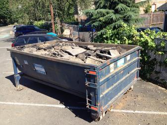 One Full Dumpster of Asphalt