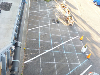 Three Parking Spaces marked in 3x3 Tiles For Asphalt Cutting