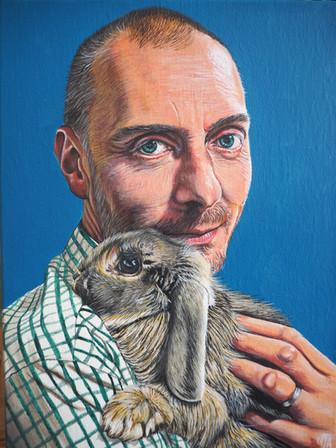 Human companion portrait with bright blue background