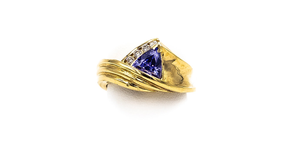 Yellow Gold Tanzanite Trillion With A 4 Channel Set Ring