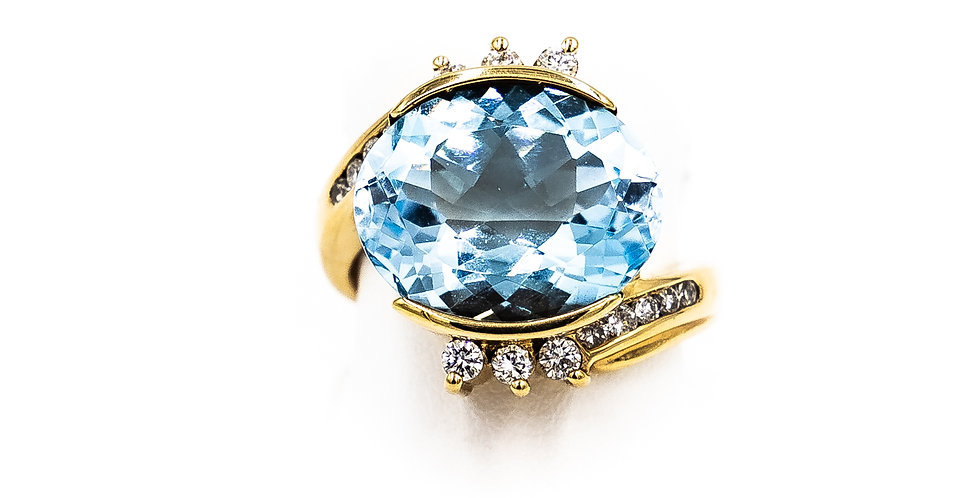 Yellow Gold Oval Blue Topaz Set East to West Ring