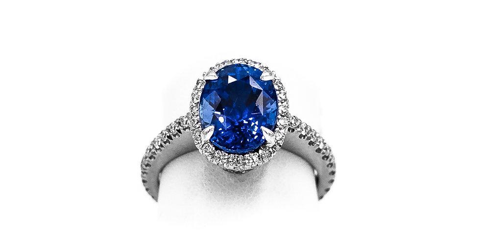 Platinum Oval Sapphire Diamond Halo Ring